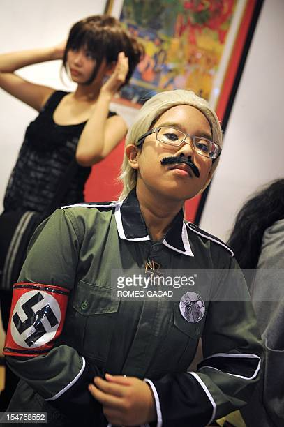 In this photograph taken on October 20 Grace Elizabeth wears a Nazi uniform during an Anime costume party at a restaurant in Jakarta The members...