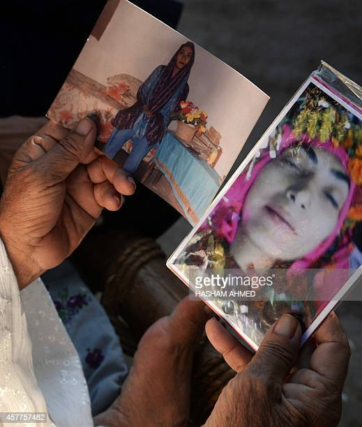 WITH 'PAKISTANUNRESTHEALTHPOLIO' BY In this photograph taken on October 20 Pakistani resident Gul Khubana poses for a photograph with images of her...