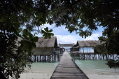 In this photograph taken on October 21 2011 cottages are built over the water at Kri Island private resort in Raja Ampat located in eastern...