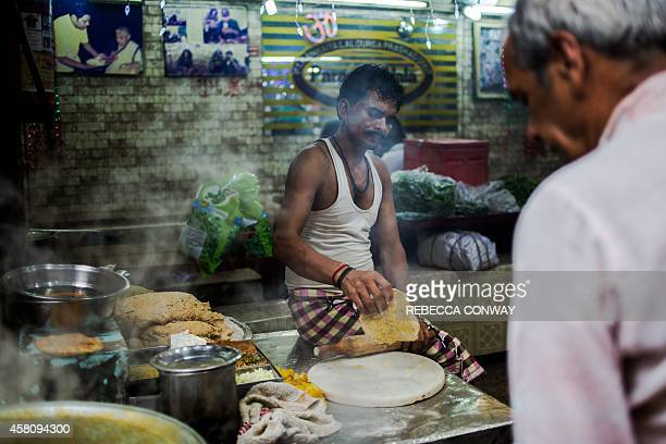 In this photograph taken on October 26 an Indian cook makes parathas fried stuffed bread at a shop in Parantha Wali Gali a street famous for making...