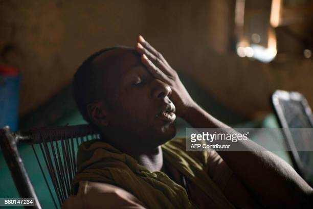 In this photograph taken on October 5 former taxi driver Mohamed I born in 1985 gestures as he sits in his home in Timbuktu Taxi driver before the...