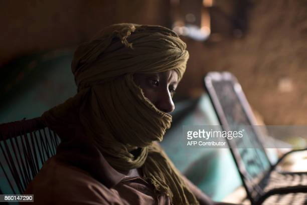 In this photograph taken on October 5 former taxi driver Mohamed I born in 1985 looks on as he sits in his home in Timbuktu Taxi driver before the...