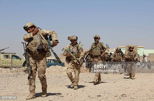 In this photograph taken on October 9 Afghan National Army commandos take position during a military operation in Helmand province MOHAMMAD