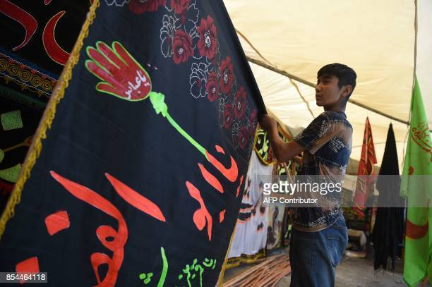 In this photograph taken on September 25 an Afghan young Shiite boy displays religious flags ahead of Ashura in Kabul Shiites across warweary...