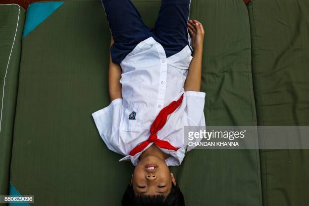 In this photograph taken on September 27 a student lies in the playground during a physical training session at their school in Shanghai Western...