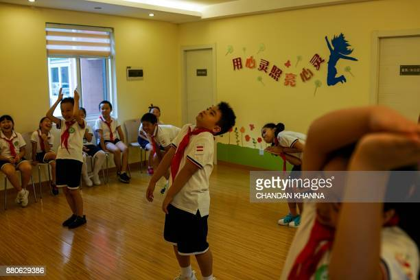 In this photograph taken on September 27 students act during an activity session at their school in Shanghai Western interest in China's school...
