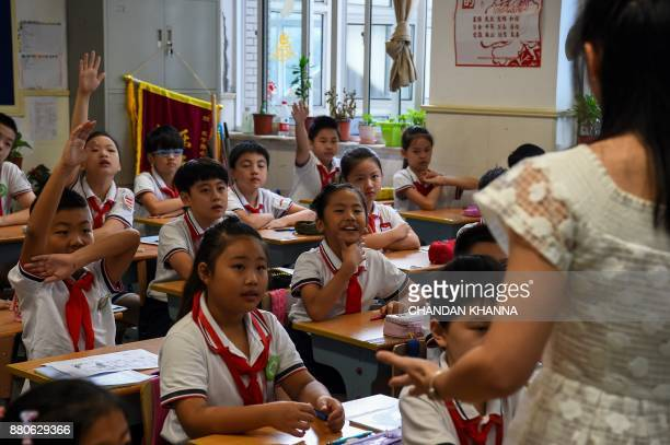 In this photograph taken on September 27 students attend a class in their school in Shanghai Western interest in China's school system and Shanghai...