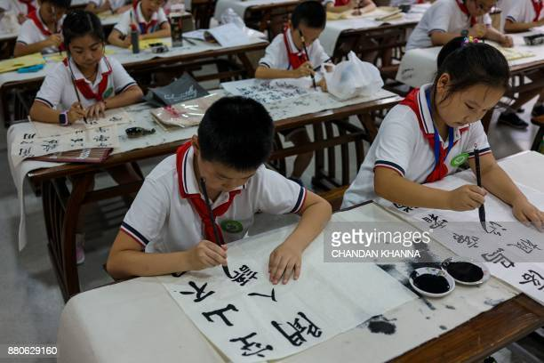 In this photograph taken on September 27 students paint during an activity session at their school in Shanghai Western interest in China's school...