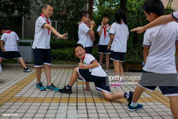 In this photograph taken on September 27 students play during recess at their school in Shanghai Western interest in China's school system and...