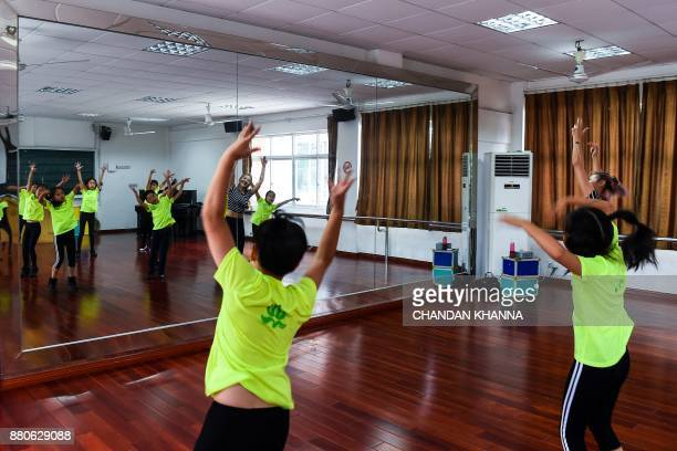 In this photograph taken on September 27 students practice dance moves during a Western dance session at their school in Shanghai Western interest in...