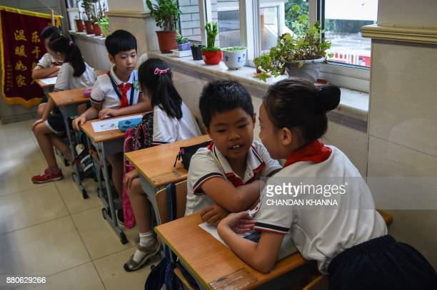 In this photograph taken on September 27 students sit in a classroom as they study in Shanghai Western interest in China's school system and Shanghai...