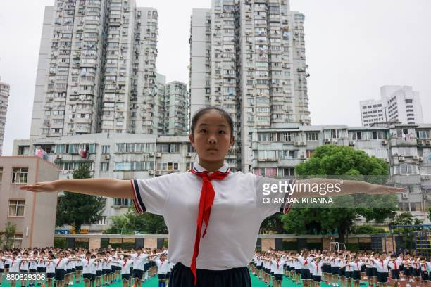 In this photograph taken on September 27 students take part in a physical training session at their school in Shanghai Western interest in China's...