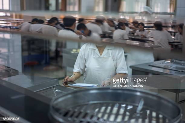 In this photograph taken on September 28 students eat their lunch in their school in Shanghai Western interest in China's school system and Shanghai...