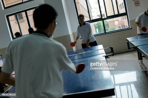 In this photograph taken on September 28 students play table tennis in their school in Shanghai Western interest in China's school system and...