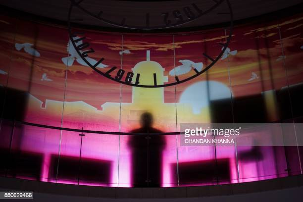 In this photograph taken on September 28 the silhouette of a statue is seen inside a school in Shanghai Western interest in China's school system and...