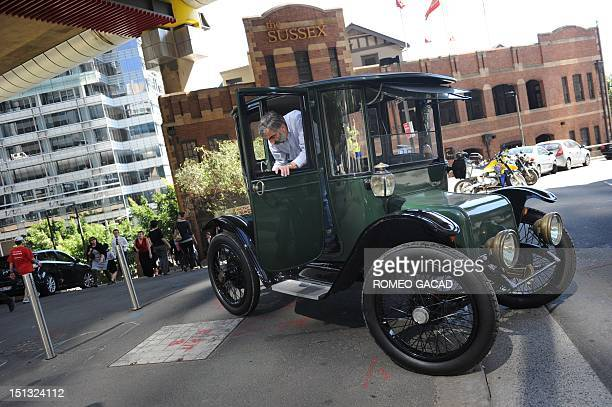 In this photograph taken on September 5 Bill Lloyd a retired Australian mechanical engineer patent attorney and vintage car collector drives his 1915...