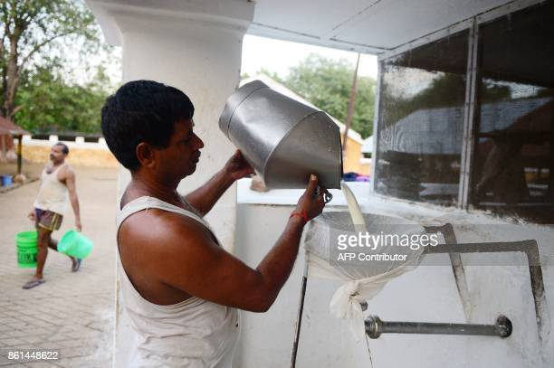In this photograph taken September 1 2017 a worker processes milk collected at a Britishera dairy farm opened in 1889 that is now run by the Indian...