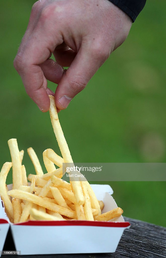 In this photo-illustration a man eats French fries purchased from a fast food outlet on January 7, 2013 in Bristol, England. A government-backed TV advert - made by Aardman, the creators of Wallace and Gromit - to promote healthy eating in England, is to be shown for the first time later today. England has one of the highest rates of obesity in Europe - costing the NHS 5 billion GDP each year - with currently over 60 percent of adults and a third of 10 and 11 year olds thought to be overweight or obese.