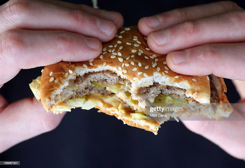 In this photo-illustration a man holds a burger purchased from a fast food outlet on January 7, 2013 in Bristol, England. A government-backed TV advert - made by Aardman, the creators of Wallace and Gromit - to promote healthy eating in England, is to be shown for the first time later today. England has one of the highest rates of obesity in Europe - costing the NHS 5 billion GDP each year - with currently over 60 percent of adults and a third of 10 and 11 year olds thought to be overweight or obese.