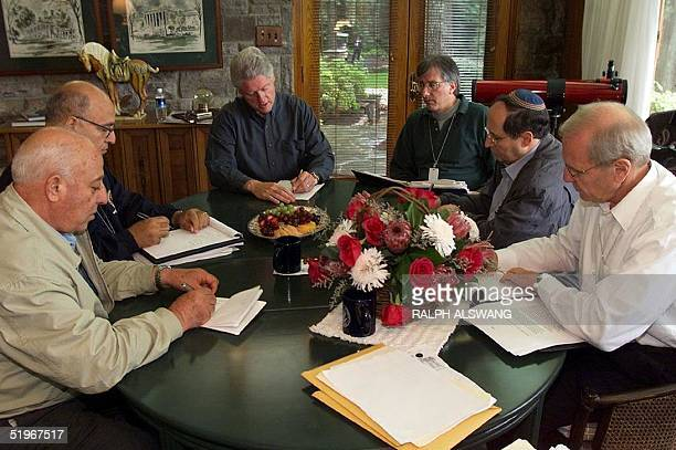In this pictre released 24 July by the White House US President Bill Clinton meets with Israeli and Palestinian negotiators 24 July 2000 at Camp...