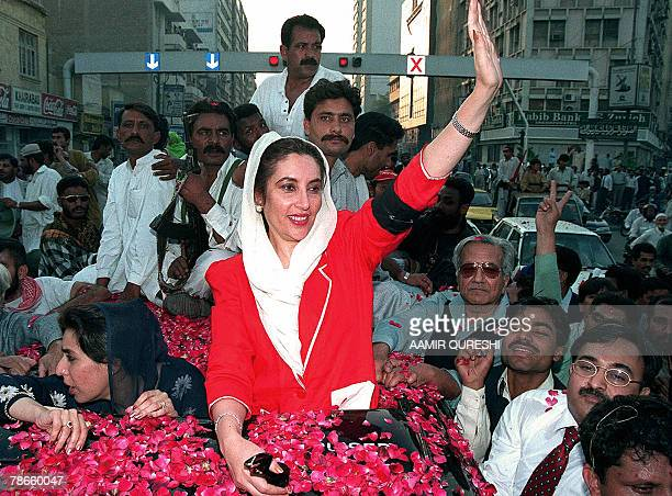 In this picture dated 08 February 1999 former premier of Pakistan Benazir Bhutto waves to her supporters during a rally organised by the newsmen...
