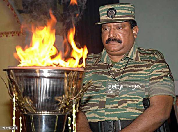 In this picture released 28 November 2005 leader of Sri Lanka's Liberation Tigers for Tamil Eelam Velupillai Prabhakaran stands in front of an...