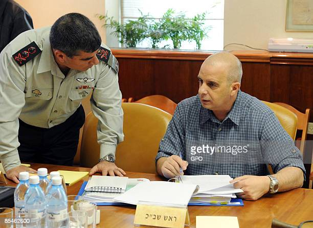 In this picture released by the Israeli Government Press Office Shin Bet security chief Yuval Diskin listens to Chief of Staff Lt Gen Gabi Ashkenazi...