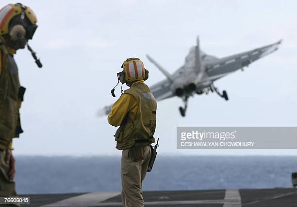 MILITARY In this picture taken 07 September 2007 a US F18 fighter plane takes off from the deck of USS Kitty Hawk aircraft carrier in the Bay of...