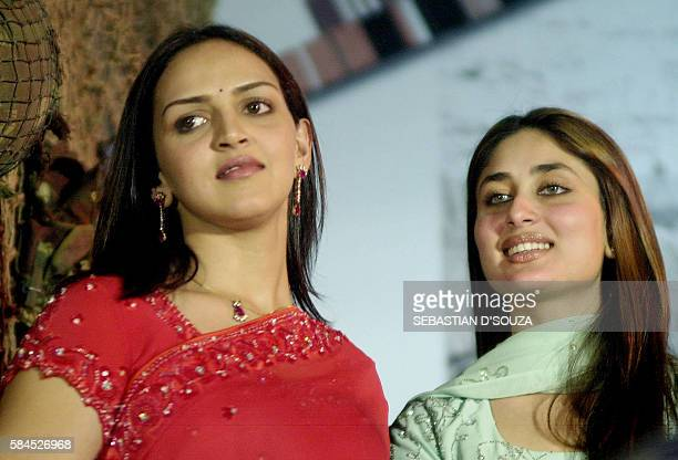In this picture taken 10 November 2003 Indian actresses Kareena Kapoor Esha Deol smile during the release of the soundtrack of the movie 'Line Of...
