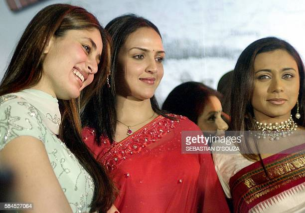 In this picture taken 10 November 2003 Indian actresses Kareena Kapoor Esha Deol and Ranee Mukherjee smile during the release of the soundtrack of...