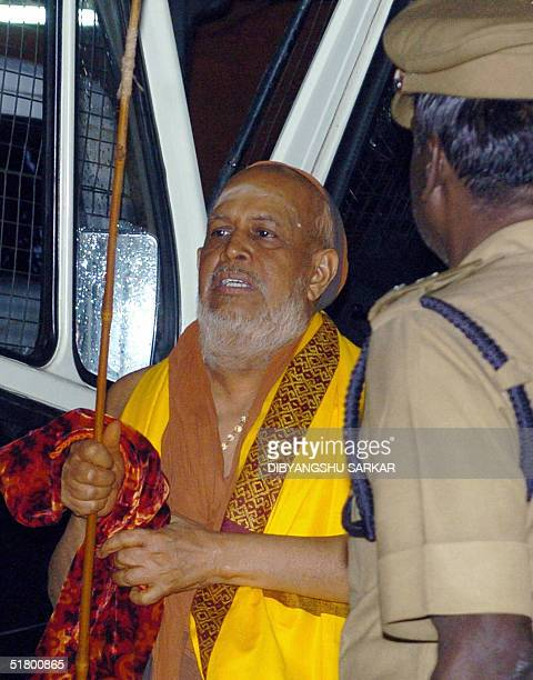 In this picture taken 12 November 2004 One of India's top Hindu religious leaders Jayendra Saraswati leaves a police van outside the Kancheepuram...
