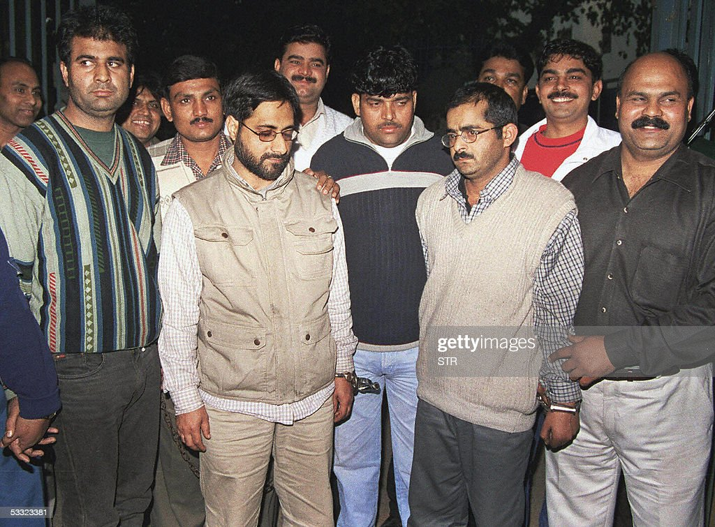 In this picture taken 16 December 2001, Indian policemen present bombing suspects Mohammed Afzal (R),Syed Abdul Rehman Geelani (2L) and Shaukat Hussain (L) in New Delhi. India's Supreme Court 04 August 2005, confirmed the death penalty of a Afzal who was convicted in a December 2001 attack on India's parliament that pushed nuclear rivals India and Pakistan to the brink of war. The sentence of Hussain who was convicted and sentenced to death by a high court was commuted to 10 year in prison. His wife and Delhi University Professor Geelani had lower court acquittals upheld by the Supreme Court, Press Trust of India said.Five armed rebels stormed the parliament on 13 December, 2001, killing eight police officers and a gardener before they were shot dead by security forces. A journalist wounded in the attack died months later of his wounds.