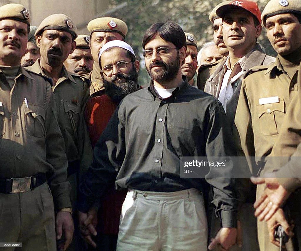 In this picture taken 18 December 2002, Indian police present Mohammed Afzal (4R), S.A.R. Geelani (3R), and Shaukat Hussain (2R) to media representatives as they arrive at court in New Delhi. India's Supreme Court 04 August 2005, confirmed the death penalty of Afzal who was convicted in a December 2001 attack on India's parliament that pushed nuclear rivals India and Pakistan to the brink of war. The sentence of Hussain who was convicted and sentenced to death by a high court was commuted to 10 year in prison. His wife and Delhi University Professor Geelani had lower court acquittals upheld by the Supreme Court, Press Trust of India said.Five armed rebels stormed the parliament on 13 December 2001, killing eight police officers and a gardener before they were shot dead by security forces. A journalist wounded in the attack died months later of his wounds.