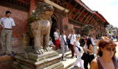 In this picture taken 25 August 2004 foreign tourists walk out of a temple at Patan also known as Lalitpur in Kathmandu Patan the oldest city in the...