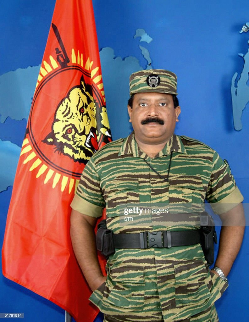In this picture taken 27 November 2003 Leader of Sri Lankan Liberation Tigers of Tamil Eelam Velupillai Prabhakaran stands next to an LTTE flag...