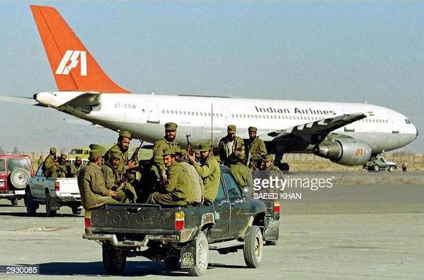 In this picture taken 30 December 1999 Taliban Islamic militia commandos ride in the rear of a truck towards an aircraft of Indian Airlines hijacked...