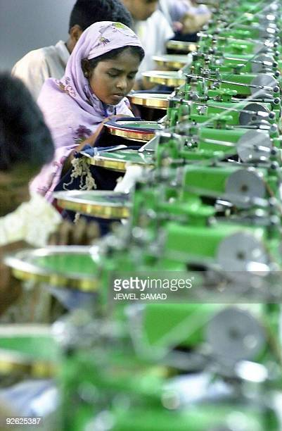 ALAM In this picture taken December 11 a Bangladeshi female worker and male coworkers work at a textile factory in Ashulia The financial turmoil...