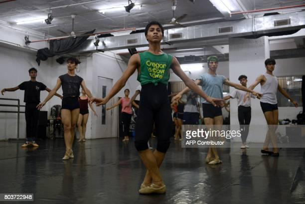 In this picture taken June 27 Indian ballet dancer Amiruddin Shah practises at a dance academy in Mumbai Amiruddin Shah the 16yearold son of a welder...