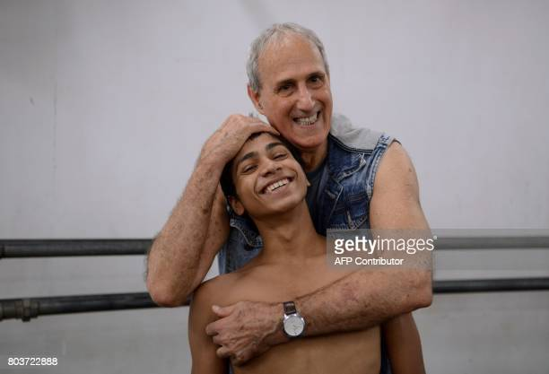 In this picture taken June 27 Indian ballet dancer Amiruddin Shah poses with IsraeliAmerican instructor Yehuda Maor at a dance academy in Mumbai...
