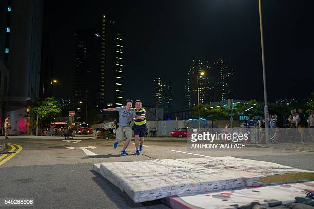 In this picture taken late on May 23 members of a film crew working with local director Herman Yau prepare to leap onto mattresses as they practice a...