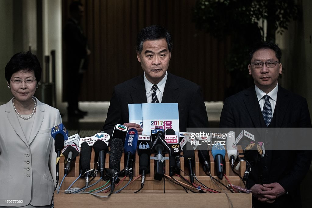 In this picture taken on April 22 Hong Kong Chief Executive Leung Chunying holds the roadmap policy document for the city's first ever public vote as...