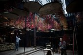 In this picture taken on April 30 workers hang incense coils at a Tin Hau temple in Hong Kong People flocked to temples on April 29 to celebrate the...