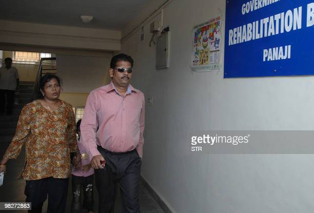 In this picture taken on April 5 prime accused in the Scarlet Keeling case Placido Carvalho walks with his wife as they enter the Children's Court in...