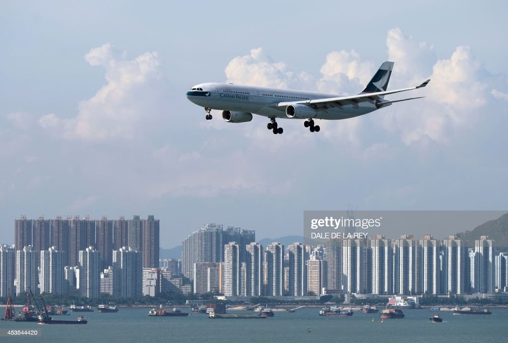 In this picture taken on August 10 a Cathay Pacific passenger plane prepares to land at Hong Kong's international airport Hong Kong flag carrier...