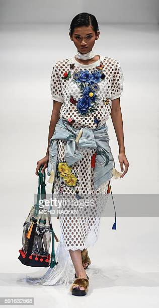 In this picture taken on August 17 a model presents a creation by Malaysian designer Zero To Ten during the 2016 Kuala Lumpur Fashion week in Kuala...