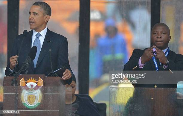 In this picture taken on December 10 2013 US President Barack Obama delivers a speech next to sign language interpreter Thamsanqa Jantjie during the...