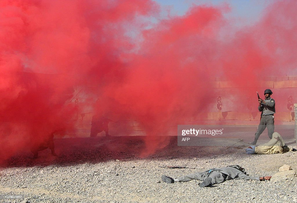 In this picture taken on December 29 Afghan National Police personnel take part in a training exercise at the a Police Training Centre in Helmand...