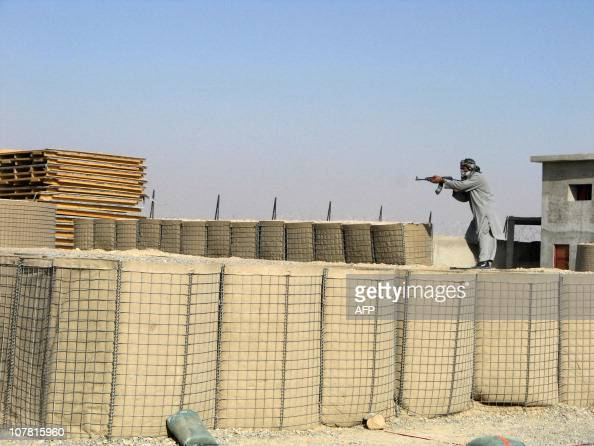 In this picture taken on December 29 an Afghan National Police personnel dressed up as a potential suspect takes part in a training exercise at the a...