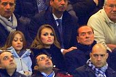 In this picture taken on December 4 2012 AC Milan's president Silvio Berlusconi sits with his new girlfriend Francesca Pascale during the Champions...