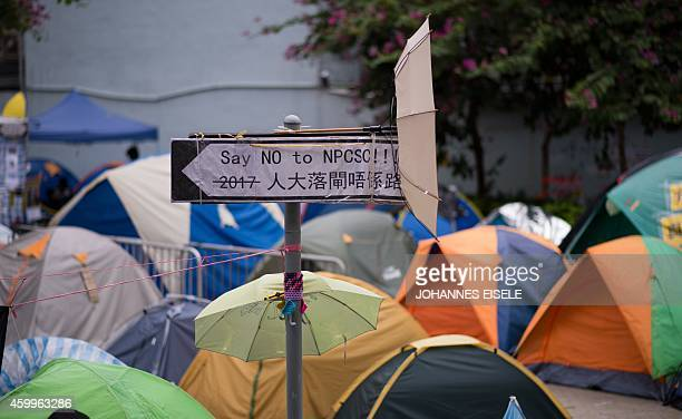 STORY 'HONG KONGCHINAPROTESTSDEMOCRACYLANGUAGE' FEATURE BY EMILY FORD In this picture taken on December 4 a road sign at the main prodemocracy...